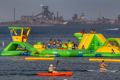 IMG_8572.jpg  Bathers and kayakers in Lake Michigan at Whilala Beach in Whiting, Indiana, with ArcelorMittal's steel mill in East Chicago, Indiana. 7/19/19