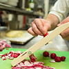 Head chef Edward Work slices radishes in preperation for the weekend crowd at the Athenaeum Hotel on Sunday, June 25, 2017. CAM BUKER/STAFF PHOTOGRAPHER