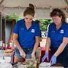 Assistant Cheesemaker Rachel Vaillancourt, left, and Culinary Manager Marlene Lucas, employees of Reverie Creamery, prepare a tomato basil grilled cheese sandwich on Tuesday, Aug. 22, 2017 in Bestor Plaza during The Taste of Chautauqua. CAM BUKER/STAFF PHOTOGRAPHER