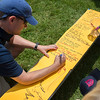 Andy Viehe writes his name on a sign in sheet alongside other alumni from the Chautauqua Boys' and Girls' club during the 125th celebration of CBGC on Sunday, July 2, 2017. CAM BUKER/STAFF PHOTOGRAPHER