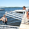 "Dominick Hetrick, left, and Tommie Adolph work together to install a dock on the shores of Lake Chautaqua on Wednesday, June 14 2017. According to Hetrick, ""it takes a good three hours with a solid crew to install a dock."" Their company, ROCK of Western NY installed a majority of the docks on the grounds in the weeks leading up to the season. CAM BUKER/STAFF PHOTOGRAPHER"