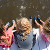 From left; Hana, Hogan, and Nova Holland from Los Angeles, CA, relax on the dock at the Boys' and Girls' Club on Monday, July 3, 2017. The Holland siblings are one of three triplet groups in attendence at the Boys' and Girls' Club during the first week of July. CAM BUKER/STAFF PHOTOGRAPHER