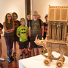 "The Clymer Central School's 6th grade class looks over artist Chuck Johnson's sculpture ""Rhino on Rollers"" on Monday, June 19 2017. CAM BUKER/STAFF PHOTOGRAPHER"