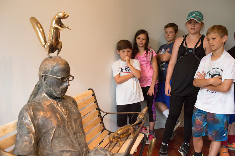 "Clymer Central School 5th grade students from left, Tanner Mihalko, Alexys Neckers, Grant Lictos, Taylor Michalski and Memphis Kopta view Bill Kofmehl's sculpture ""Squirrel Whisperer"" Monday, June 19, 2017. CAM BUKER/STAFF PHOTOGRAPHER"