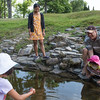Marites Grimmelbein and her husband Greg catch tadpoles with their children, Felicia, left, 8, and Sophia, 3, on Friday, June 16 2017. The Grimmelbein family, who are from Garden Valley, PA have been coming to Chautauqua for years. CAM BUKER/STAFF PHOTOGRAPHER