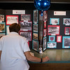 Carol Calarco; who has spent nineteen years as the  nurse at The Chautauqua Boys' and Girls' club, looks over historic photos of past summers at Chautauqua during the 125th year celebration of CBGC. CAM BUKER/STAFF PHOTOGRAPHER