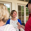 Obi Felton, center, speaks with Chautauquans on the back porch of the Amphitheater following her lecture on Monday, June 26, 2017. Felton currently leads the early stage projects at X, the team behind self-driving cars. CAM BUKER/STAFF PHOTOGRAPHER