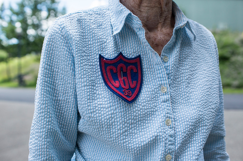 """Isabel Pedersen shows off her 1939 summer Chautauqua Girls' Club patch during the Boys' and Girls' Club of Chautauqua 125th celebration on Sunday, July 2, 2017. """"My friends and I tied together war canoes to go pick lillies at the lily pad"""" said Pedersen. Pederson is a lifelong Chautauquan. CAM BUKER/STAFF PHOTOGRAPHER"""