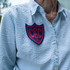 "Isabel Pedersen shows off her 1939 summer Chautauqua Girls' Club patch during the Boys' and Girls' Club of Chautauqua 125th celebration on Sunday, July 2, 2017. ""My friends and I tied together war canoes to go pick lillies at the lily pad"" said Pedersen. Pederson is a lifelong Chautauquan. CAM BUKER/STAFF PHOTOGRAPHER"