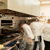 The Athenaeum Hotel kitchen staff stays busy during dinner hour on Sunday, June 25, 2017. CAM BUKER/STAFF PHOTOGRAPHER