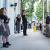 "Rebekah Howell, left, sings ""O Mio Babbino Caro"" as Steven Osgood, center, conducts ""The Opera Invasion"" on the porch of the Athenaeum Hotel on Sunday, June 25, 2017. CAM BUKER/STAFF PHOTOGRAPHER"