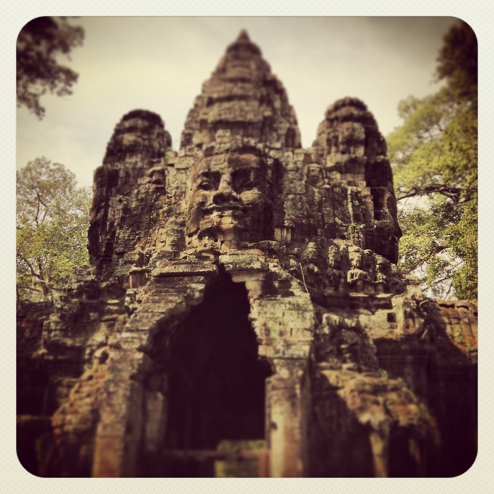 The Victory Gate, one of five gates in the fortifying wall (3km on each side) that surround and protect the city of Angkor Thom