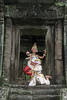 Khmer-hanuman-and-apsara-dancers-in-a-light-rain-at-The-Terrace-of-the-Elephanats,-Angkor-Thom,-Cambodia