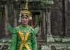 Woman-in-apsara-costume-in-a-light-rain,-Terrace-of-the-Elephants,-Angkor-Thom,-Cambodia