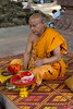 A buddhist monk at a shrine in  the woods near the Angkor Thom Temple in Cambodia, Asia.