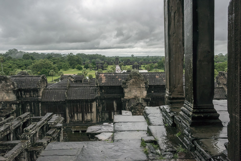View-from-the-upper-terrace-to-the-West-Portico-on-a-rainy-day,-Angkor-Wat,-Cambodia