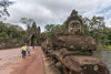 South-gate-and-causeway-over-moat-with-naga-railing-lines-carried-by-asuras-(ogres),-Angkor_Thom,-Cambodia