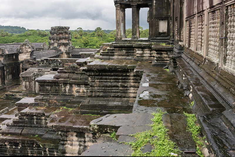 Massive-stone-structure-of-Angkor-Wat-seen-from-the-upper-terrace,-rainy-day,-Siem-Reap-Cambodia