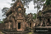 West-face-of-North-Library-with-Krishna-killing-the-demon-kng-Kamsa,-Banteay-Srei,-Cambodia