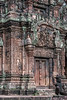 Central-tower-of-west-entrance-of-sanctuary-with-dvarapala-guardians-and-intricate-carvings,-Banteay-Srei,-Cambodia