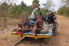 Yann and Emilie and their motorbike drivers on the bamboo train.
