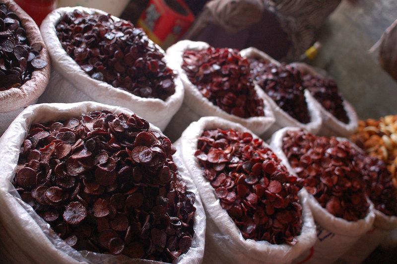 Some betel nuts, chewing these makes your teeth black or red but it keeps them from falling out.