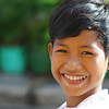 "A smiling boy just outside the central market (Psar Nath) - Battambang, Cambodia.  To view my travel gallery from Battambang, Cambodia click on the photo. <a href=""http://nomadicsamuel.com"">http://nomadicsamuel.com</a>"