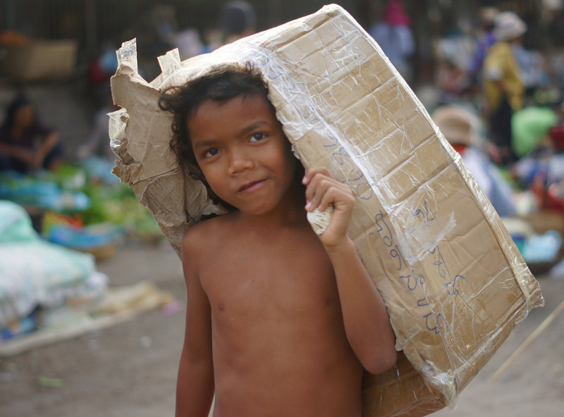"A Khmer boy carrying his box just outside Psar Nath (Central Market) - Battambang, Cambodia.  This is a travel photo from Battambang, Cambodia. <a href=""http://nomadicsamuel.com"">http://nomadicsamuel.com</a>"