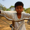 "A Khmer boy posing on his bicycle in a rural village outside of Battambang, Cambodia.  This is a travel photo from Battambang, Cambodia. <a href=""http://nomadicsamuel.com"">http://nomadicsamuel.com</a>"