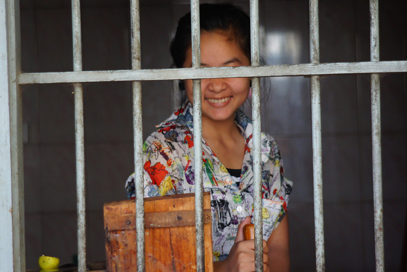 Today's daily travel photo is of a lovely Khmer lady flashing a candid smile in the downtown area of Battambang, Cambodia during one of my random wanders.