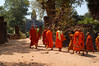 Cambodia, Angkor: Monks arriving at Bakong Temple.