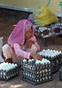 Cambodia, Phnom Penh: A woman selling eggs to restaurants.