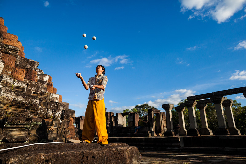 "Viban juggling outside of the temples of Angkor Wat in Siem Reap, Cambodia. Viban is one of the star performers in ""The Adventure"", a Phare Circus show."