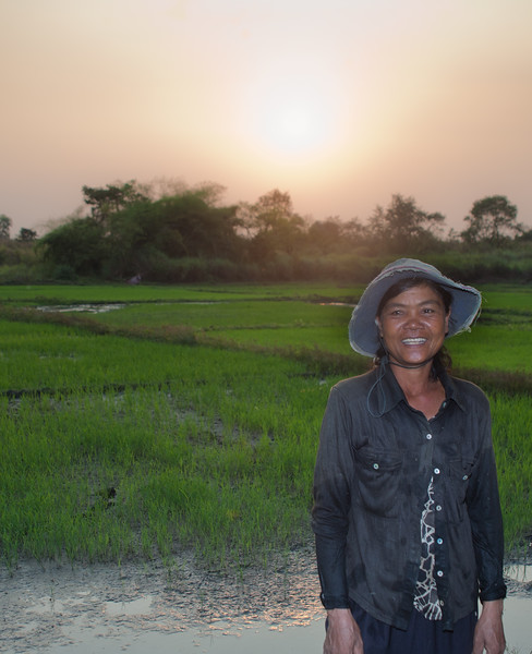 lady in front of her rice field