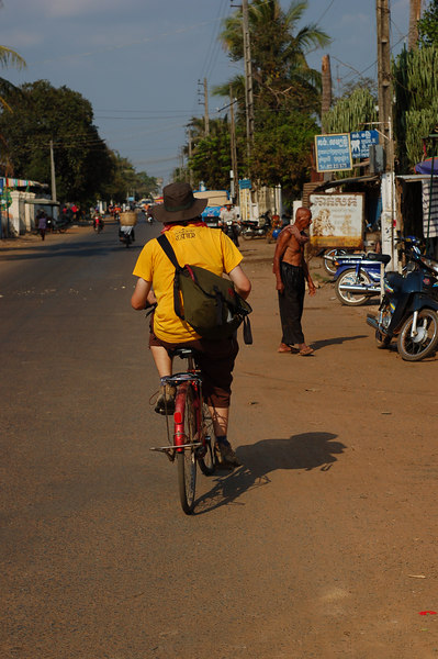 Yann on his too small bicycle with the seat pointing upwards (this has been a common theme in SE-Asia).