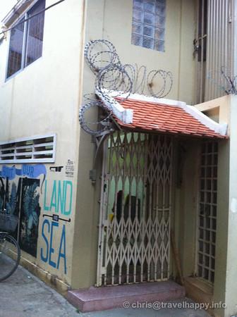 Razor wire and arty graffiti, Phnom Penh