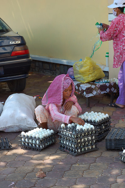 A woman selling eggs to restaurants.