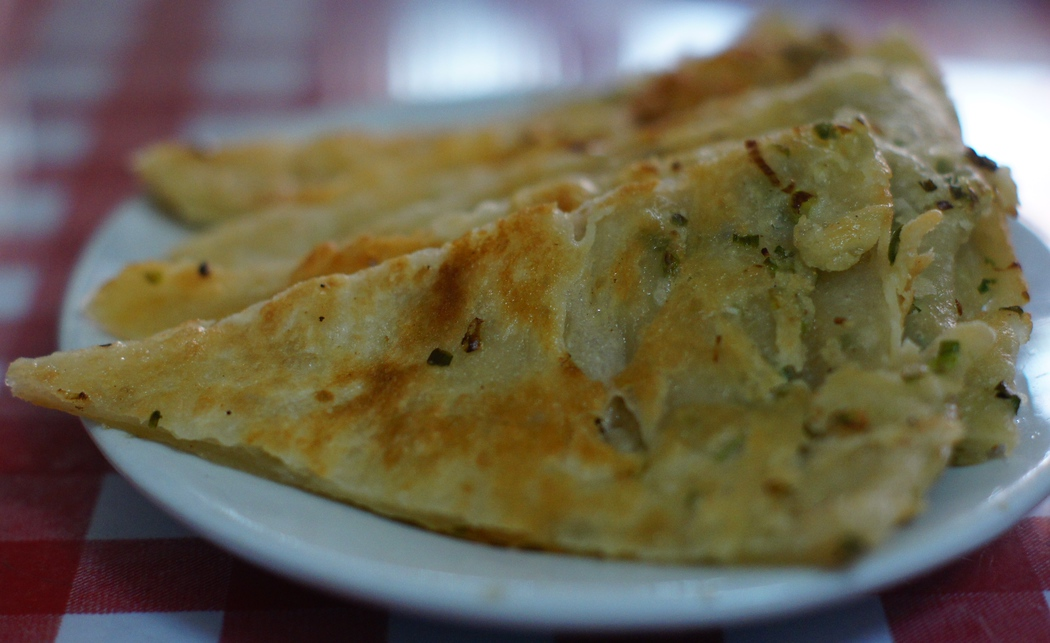 Today's daily travel photo is of some Chinese style green onion cake wedges found in a Chinese restaurant in Phnom Penh, Cambodia.