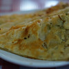 "<a href=""http://nomadicsamuel.com/photo-blog/green-onion-cake-phnom-penh-cambodia-travel-photo"">http://nomadicsamuel.com/photo-blog/green-onion-cake-phnom-penh-cambodia-travel-photo</a> : Today's daily travel photo is of some Chinese style green onion cake wedges found in a Chinese restaurant in Phnom Penh, Cambodia."