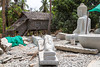 Stone carvings of buddhas and figurines at the Santok stone carving village in central Cambodia, Asia.