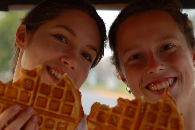 Margaux and Emilie enjoy their waffle breakfast on the tuk-tuk