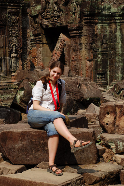 Margaux sits among some of the ruins of Ta Som Temple