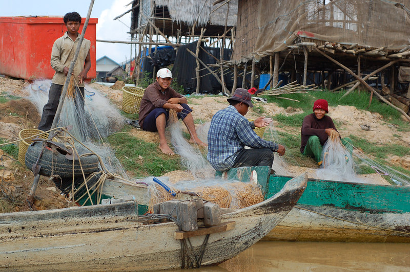 The fisherman preparing their nets.
