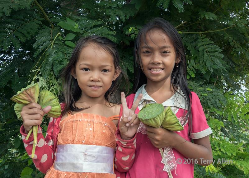 Girls selling lotus seed pods