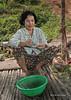 Woman-making-a-net,-Sangat-Siem-Reap,-Cambodia