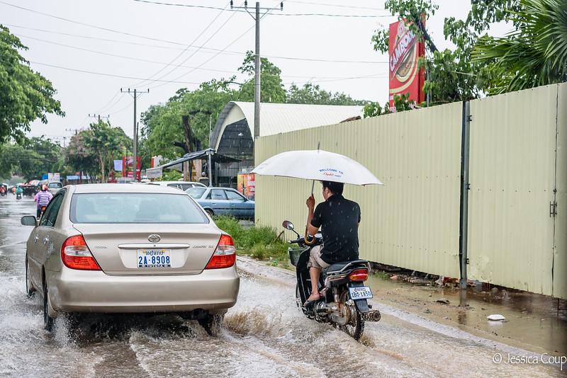 Biking Under an Umbrella