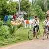 Biking Past the Sculptures