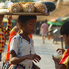 "Khmer children on the tourist beach carrying and selling fruit to farangs - Sihanoukville, Cambodia.  This is a travel photo from Sihanoukville, Cambodia. <a href=""http://nomadicsamuel.com"">http://nomadicsamuel.com</a>"