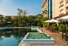 The swimming pool area at the Somadevi Angkor Hotel in Siem Reap, Cambodia, Asia.