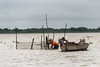 Fisherman-setting-his-nets,-monsoon-season,-Tonle-Sap,-Cambodia